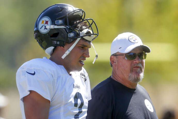 Pittsburgh Steelers quarterback Mason Rudolph (2), left, walks with offensive coordinator Randy Fichtner between drills during an NFL football practice, Wednesday, Sept. 18, 2019, in Pittsburgh. (AP Photo/Don Wright)