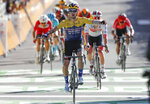 Slovenia's Primoz Roglic celebrates as he crosses the finish line to win the fourth stage of the Tour de France cycling race over 160,5 kilometers (99,7 miles) with start in Sisteron and finish in Orcieres-Merlette, southern France, Tuesday, Sept.1, 2020. (AP Photo/Christophe Ena, Pool)