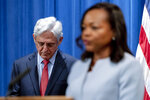 Assistant Attorney General for Civil Rights Kristen Clarke, right, accompanied by Attorney General Merrick Garland, left, speaks at a news conference at the Department of Justice in Washington, Thursday, Aug. 5, 2021, to announce that the Department of Justice is opening an investigation into the city of Phoenix and the Phoenix Police Department. (AP Photo/Andrew Harnik)