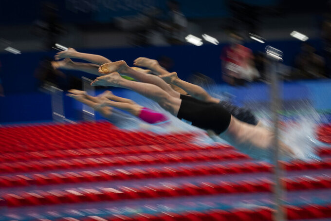 Participants compete at Men's 100m Butterfly - S14 Heat 2 at the Tokyo Aquatics Centre during the Tokyo 2020 Paralympic Games, Wednesday, Aug. 25, 2021, in Tokyo, Japan. (AP Photo/Emilio Morenatti)