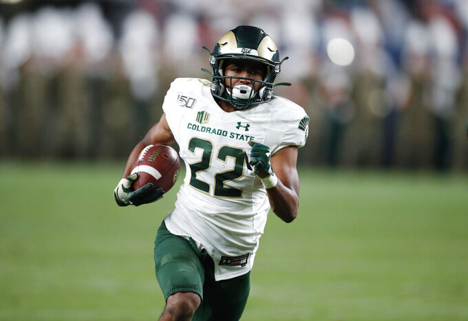 Colorado State wide receiver Dante Wright runs for a touchdown against Colorado during the second quarter of an NCAA college football game Friday, Aug. 30, 2019, in Denver. (AP Photo/David Zalubowski)