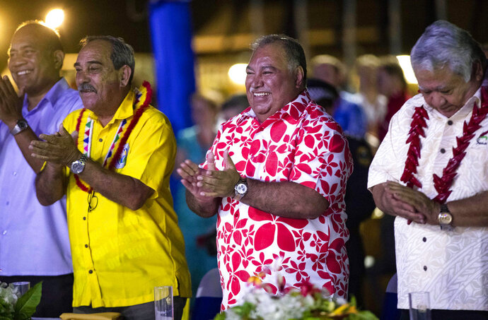 FILE - In this Sept. 3, 2018, file photo, Nauru's President Baron Waqa, center,  attends the opening ceremony of the Pacific Islands Forum in Nauru. Tensions over China and refugees are running high at a meeting of Pacific leaders after host Nauru accused a Chinese official of bullying and temporarily detained a New Zealand journalist. (Jason Oxenham/Pool Photo via AP, File)