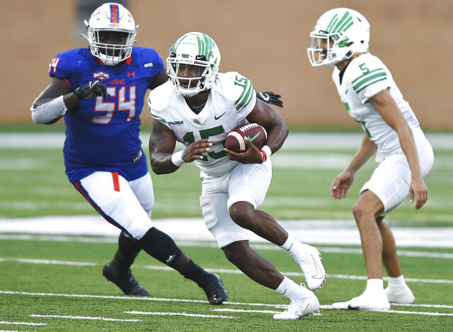 North Texas' Tre Siggers (15) takes the handoff from Jason Bean (5) during the first half against Houston Baptist in an NCAA college football game Saturday, Sept. 5, 2020, in Denton, Texas. (Al Key/The Denton Record-Chronicle via AP)
