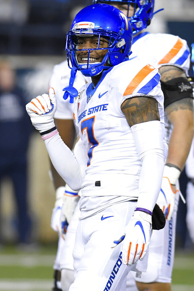 Boise State wide receiver Akilian Butler (7) smiles after Utah State cornerback DJ Williams called called for an unsportsmanlike-conduct penalty during the first half of an NCAA college football game Saturday, Nov. 23, 2019, in Logan, Utah. (AP Photo/Eli Lucero)