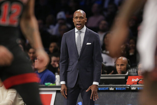 Brooklyn Nets interim head coach Jacque Vaughn talks to his players during the first half of an NBA basketball game against the Chicago Bulls at the Barclays Center, Sunday, March 8, 2020, in New York. (AP Photo/Seth Wenig)
