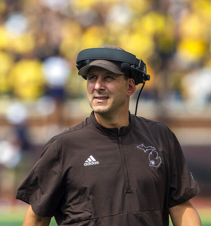 Western Michigan head coach Tim Lester looks up at the scoreboard in the fourth quarter of an NCAA college football game against Michigan in Ann Arbor, Mich., Saturday, Sept. 4, 2021. Michigan won 47-14. (AP Photo/Tony Ding)