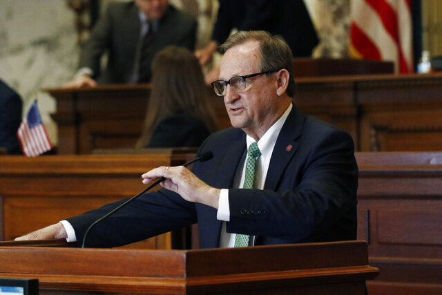 Sen. Dean Kirby, R-Pearl, speaks on a concurrent resolution that would suspend their business and grant administrative pay to some local governmental entities in light of the coronavirus situation, Tuesday, March 17, 2020, in Jackson, Miss. (AP Photo/Rogelio V. Solis)