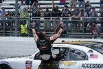 Josh Berry (8) celebrates winning the rain delayed NASCAR Xfinity Series auto race at Martinsville Speedway in Martinsville, Va., Sunday, April 11, 2021. (AP Photo/Steve Helber)