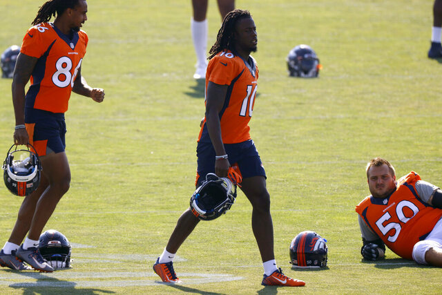 Denver Broncos wide receiver Jerry Jeudy takes part in drills at the team's NFL football training camp Friday, Aug. 14, 2020, in Englewood, Colo. (AP Photo/David Zalubowski)