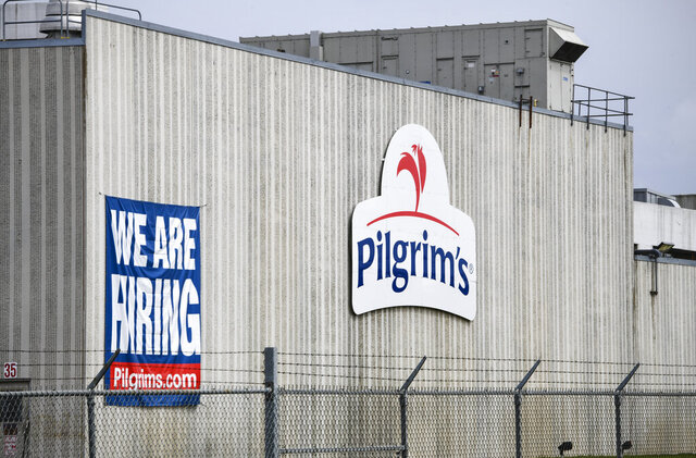 FILE - This April 28, 2020 file photo shows the Pilgrim's Pride plant in Cold Spring. Minn.  Pilgrim's Pride Corp. has reached a plea agreement with the U.S. government, Wednesday, Oct. 14,  over charges of price-fixing in the chicken industry. If a federal judge approves the agreement, Pilgrim's Pride would pay a fine of $110.5 million as a penalty for restraining competition. (Dave Schwarz/St. Cloud Times via AP)