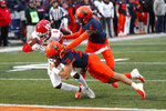 CORRECTS ID AT RIGHT TO NATE HOBBS, NOT TONY ADAMS - Rutgers wide receiver Mohamed Jabbie (6) scores on a pass as Illinois defensive back Sydney Brown (30) and Nate Hobbs, right,  defend during the first half of an NCAA college football game Saturday, Nov. 2, 2019, in Champaign, Ill. (AP Photo/Charles Rex Arbogast)