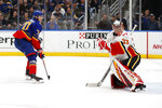 St. Louis Blues' Oskar Sundqvist, of Russia, stakes past Calgary Flames goaltender David Rittich, right, of the Czech Republic, after scoring during the second period of an NHL hockey game Thursday, Nov. 21, 2019, in St. Louis. (AP Photo/Jeff Roberson)