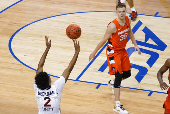 Virginia guard Reece Beekman (2) launches the game winning shot as Syracuse guard Buddy Boeheim (35) watches during the second half of an NCAA college basketball game in the quarterfinal round of the Atlantic Coast Conference tournament in Greensboro, N.C., Thursday, March 11, 2021. Virginia won the game 72-69. (AP Photo/Gerry Broome)