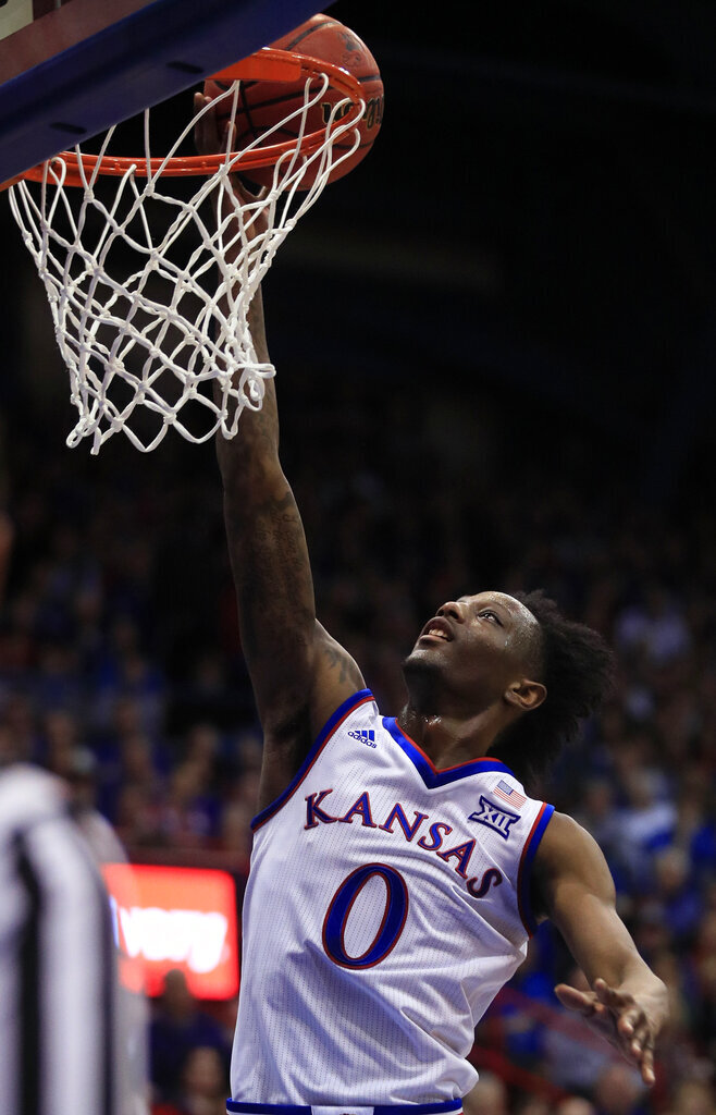 Kansas guard Marcus Garrett (0) scores during the first half of an NCAA college basketball game against Iowa State in Lawrence, Kan., Monday, Jan. 21, 2019. Garrett scored 16 points in the game. Kansas defeated Iowa State 80-76. (AP Photo/Orlin Wagner)