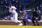 Chicago Cubs' Kris Bryant (17) hits a two-run double against the New York Mets during the third inning of a baseball game, Thursday, April, 22, 2021, in Chicago. (AP Photo/David Banks)