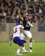 Texas A&M quarterback Kellen Mond (11) passes downfield over Northwestern State linebacker Brice Borgeson (53) during the first half of an NCAA college football game Thursday, Aug. 30, 2018, in College Station, Texas. (AP Photo/Sam Craft)