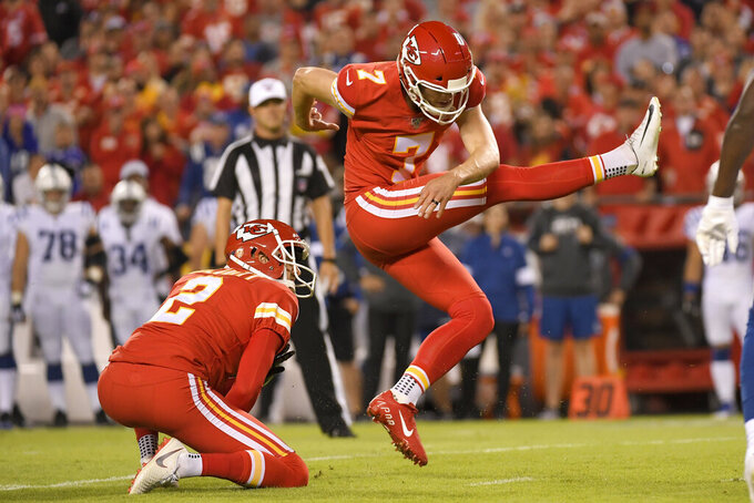 Kansas City Chiefs' Harrison Butker (7) kicks a field goal with Dustin Colquitt (2) holding, during the first half of an NFL football game against the Indianapolis Colts in Kansas City, Mo., Sunday, Oct. 6, 2019. (AP Photo/Reed Hoffmann)