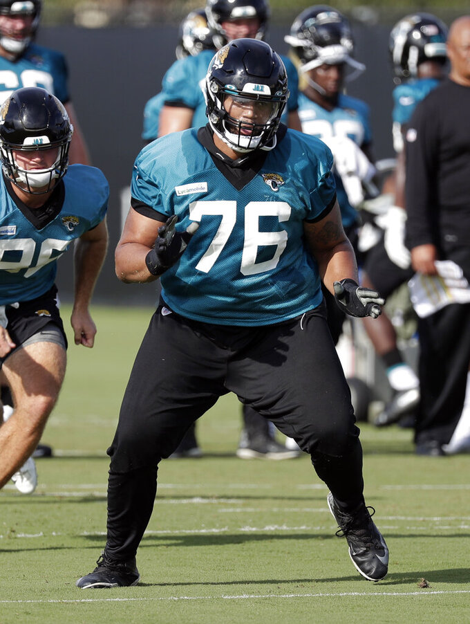 FILE - In this July 26, 2019, file photo, Jacksonville Jaguars offensive tackle Will Richardson (76) performs a drill during NFL football practice at the teams training facility in Jacksonville, Fla. The Jacksonville Jaguars likely will be without starting left tackle Cam Robinson for their season opener  Making matters worse,  backup offensive tackle Cedric Ogbuehi was ruled out because of a nagging hamstring injury. That leaves second-year pro Will Richardson to make his first career start,  and not at his usual position. (AP Photo/John Raoux, File)
