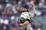 Milwaukee Brewers' Corbin Burnes pitches against the San Francisco Giants during the first inning of a baseball game in San Francisco, Monday, Aug. 30, 2021. (AP Photo/Jeff Chiu)