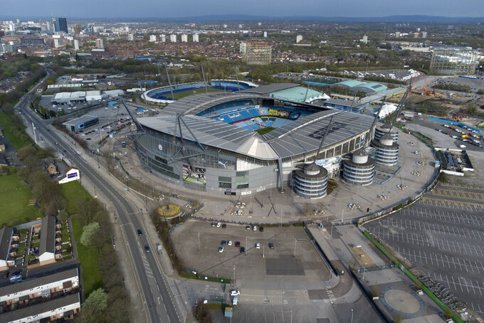 Manchester City's Etihad Stadium is seen after the collapse of English involvement in the proposed European Super League, Manchester, England, Wednesday, April 21, 2021. Manchester City were the first club to pull out after Chelsea had signalled their intent to do so by preparing documentation to withdraw. (AP Photo/Jon Super)