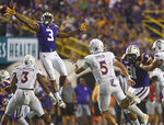 LSU safety Jacoby Stevens (3) tries to block a pass by Northwestern State quarterback Shelton Eppler (5) in the first half of an NCAA football game against Saturday in Baton Rouge, La., Sept. 14, 2019. (AP Photo/Patrick Dennis)