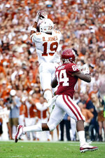 Texas defensive back Brandon Jones (19) intercepts a pass thrown by Oklahoma quarterback Kyler Murray (1) during the first half of an NCAA college football game at the Cotton Bowl, Saturday, Oct. 6, 2018, in Dallas. (AP Photo/Cooper Neill)