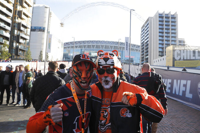 Cincinnati Bengals fans pose for photos before an NFL football game between the Los Angeles Rams and the Bengals, Sunday, Oct. 27, 2019, at Wembley Stadium in London. (AP Photo/Frank Augstein)
