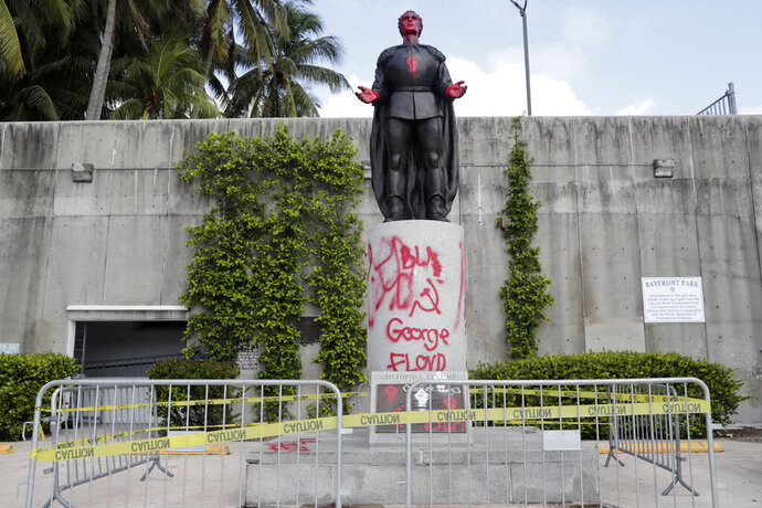 A statue of Christopher Columbus is shown vandalized at Bayfront Park in Miami, Thursday, June 11, 2020. Miami police say that several people were arrested for vandalizing the statue of Columbus and Juan Ponce de León during a protest Wednesday. Protests continue over the death of George Floyd, a black man who died last month while in police custody in Minneapolis. (AP Photo/Lynne Sladky)