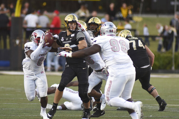 Vanderbilt quarterback Riley Neal (6) is pressured by the UNLV defense in the second half of an NCAA college football game Saturday, Oct. 12, 2019, in Nashville, Tenn. (AP Photo/Mike Strasinger)