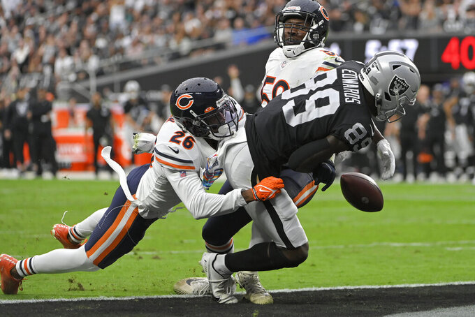 Las Vegas Raiders wide receiver Bryan Edwards (89) misses a catch against Chicago Bears safety Deon Bush (26) during the first half of an NFL football game, Sunday, Oct. 10, 2021, in Las Vegas. (AP Photo/David Becker)