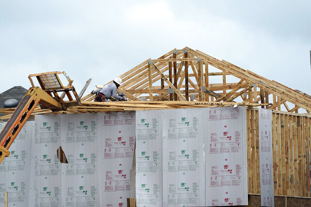 FILE - This Sept. 24, 2020 file photo shows a new home under construction in Houston.  The number of newly issued permits to build fresh housing rose 6.2% in November on a seasonally adjusted basis. Housing starts rose 1.2%, and are up 12.8% higher than a year ago, the Commerce Department reported Thursday, Dec. 17,  to an annualized rate of 1.547 million.  .(AP Photo/David J. Phillip, File)