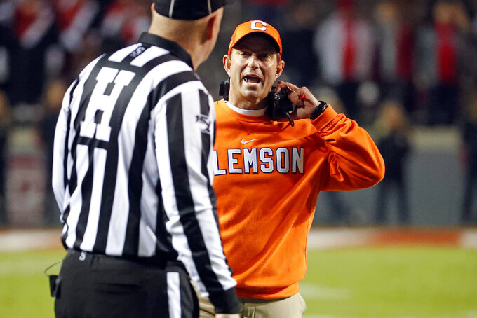 Clemson head coach Dabo Swinney speaks with an official during the second half of an NCAA college football game against North Carolina State in Raleigh, N.C., Saturday, Nov. 9, 2019. (AP Photo/Karl B DeBlaker)
