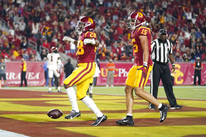 Southern California running back Keaontay Ingram (28) celebrates with wide receiver Drake London (15) after Ingram's rushing touchdown during the first half of an NCAA college football game against Oregon State Saturday, Sept. 25, 2021, in Los Angeles. (AP Photo/Marcio Jose Sanchez)