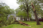 "A tree just scraps the front of the Hadden home in Fondren in Jackson, Miss., after falling during severe weather that moved through the Jackson, Miss., metro area Tuesday afternoon, May 4, 2021. ""I was just looking at that tree, thinking, 'I probably need to get that cut down,'""said Lisa Hadden, of Jackson, Miss. (Barbara Gauntt/The Clarion-Ledger via AP)"