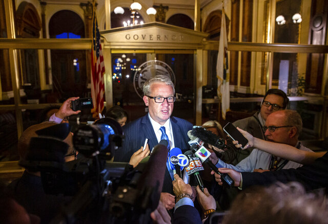FILE - In this  Friday, May 31, 2019 file photo, Illinois House Republican Leader Jim Durkin, R-Western Springs, speaks with the media after visiting with Illinois Senate President John Cullerton, D-Chicago, and Gov. J.B. Pritzker at the Capitol in Springfield, Ill. he speaker of the Illinois House said Wednesday, Jan. 8, 2020 that he had no knowledge of an alleged unreported rape that was referenced in an email written in 2012 by one of his close friends, a powerful lobbyist, and sent to the office of former Gov. Pat Quinn.(Justin L. Fowler/The State Journal-Register via AP, File)