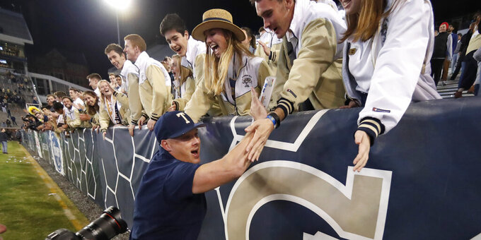 Georgia Tech coach Geoff Collins celebrates with fans after Georgia Tech defeated North Carolina State 28-26 in an NCAA college football game Thursday, Nov. 21, 2019, in Atlanta. (AP Photo/John Bazemore)