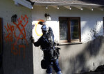 A member of a search and rescue crew marks a home as searched Saturday, Jan. 13, 2018, in Montecito, Calif. (AP Photo/Marcio Jose Sanchez)