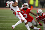 Ohio State defensive back Damon Arnette, right, tackles Wisconsin receiver Kendric Pryor during the first half of an NCAA college football game Saturday, Oct. 26, 2019, in Columbus, Ohio. (AP Photo/Jay LaPrete)