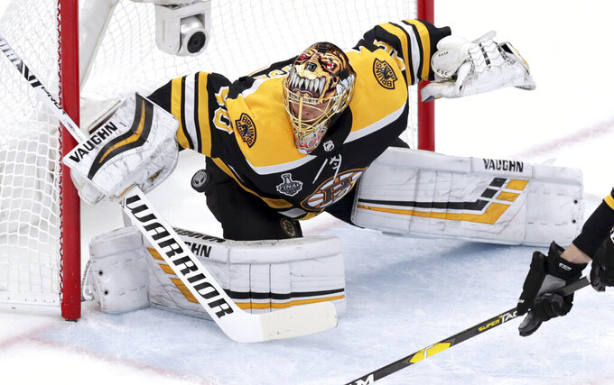 Boston Bruins goaltender Tuukka Rask, of Finland, makes a save against the St. Louis Blues during the first period in Game 5 of the NHL hockey Stanley Cup Final, Thursday, June 6, 2019, in Boston. (AP Photo/Charles Krupa)