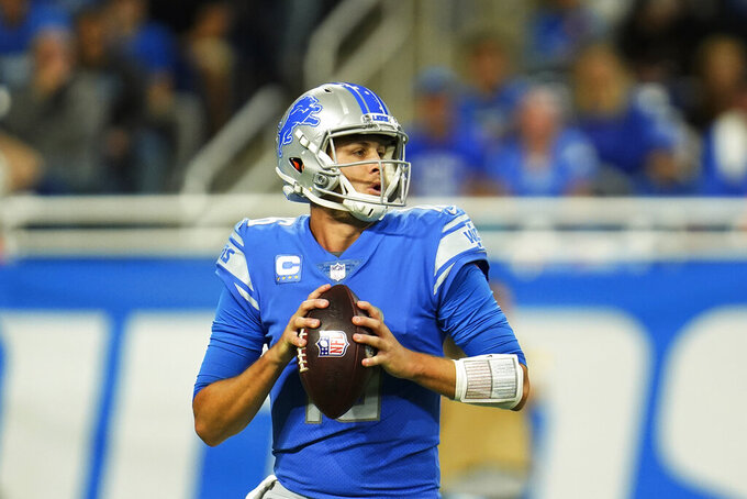 Detroit Lions quarterback Jared Goff looks downfield during the first half of an NFL football game against the Cincinnati Bengals, Sunday, Oct. 17, 2021, in Detroit. (AP Photo/Paul Sancya)