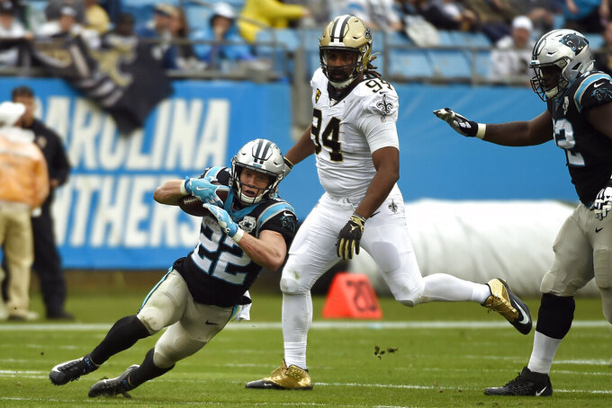 Carolina Panthers running back Christian McCaffrey (22) runs while New Orleans Saints defensive end Cameron Jordan (94) chases during the second half of an NFL football game in Charlotte, N.C., Sunday, Dec. 29, 2019. (AP Photo/Mike McCarn)