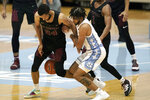 North Carolina Central guard Nicolas Fennell (24) and North Carolina guard R.J. Davis struggle for possession of the ball during the second half of an NCAA college basketball game in Chapel Hill, N.C., Saturday, Dec. 12, 2020. (AP Photo/Gerry Broome)