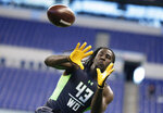 FILE - In this Feb. 27, 2016, file photo, Mississippi State receiver De'Runnya Wilson runs a drill at the NFL football scouting combine in Indianapolis. Authorities say the death of Wilson, a former Mississippi State football player whose body was found in an Alabama home Tuesday, Jan. 21, 2020, is being investigated as a homicide. (AP Photo/Michael Conroy, File)