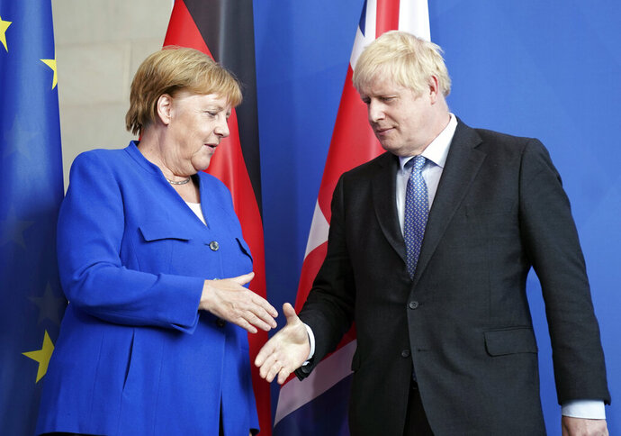 Germany's Chancellor Angela Merkel and British Prime Minister Boris Johnson attend a joint press conference, in Berlin, Wednesday, Aug. 21, 2019. German Chancellor Angela Merkel says she plans to discuss with UK Prime Minister Boris Johnson how Britain's exit from the European Union can be