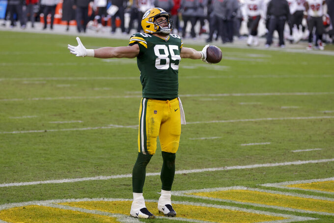 Green Bay Packers' Robert Tonyan celebrates after making an eight-yard touchdown pass during the second half of the NFC championship NFL football game in Green Bay, Wis., Sunday, Jan. 24, 2021. (AP Photo/Matt Ludtke)