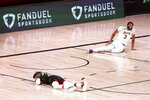 Houston Rockets' Robert Covington, left, and Los Angeles Lakers' Anthony Davis (3) sit injured on the court during the second half of an NBA conference semifinal playoff basketball game Tuesday, Sept. 8, 2020, in Lake Buena Vista, Fla. (AP Photo/Mark J. Terrill)