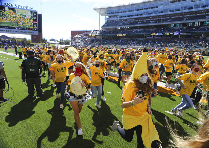 The Baylor Line students run onto the field before Baylor's NCAA college football game against TCU in Waco, Texas, Saturday, Oct. 31, 2020. (Jerry Larson/Waco Tribune-Herald via AP)