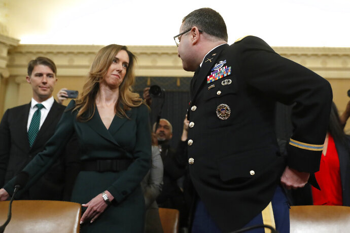 Jennifer Williams, an aide to Vice President Mike Pence, left, and National Security Council aide Lt. Col. Alexander Vindman, arrive to testify before the House Intelligence Committee on Capitol Hill in Washington, Tuesday, Nov. 19, 2019, during a public impeachment hearing of President Donald Trump's efforts to tie U.S. aid for Ukraine to investigations of his political opponents. (AP Photo/Andrew Harnik)