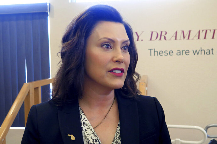 Michigan Gov. Gretchen Whitmer speaks after touring the Hope Network Neuro Rehabilitation campus Thursday, May 16, 2019, in East Lansing, Mich. The Democrat says she is open to letting drivers opt out of mandatory unlimited medical coverage in their auto insurance policies, but opposes a full opt-out option. (AP Photo/David Eggert)