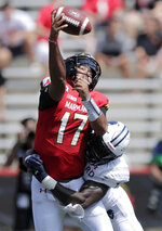 Maryland quarterback Josh Jackson, left, is hit by Howard defensive lineman Elton Jean-Baptiste while attempting a pass during the first half of an NCAA college football game, Saturday, Aug. 31, 2019, in College Park, Md. (AP Photo/Julio Cortez)